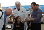 Samah, 10, receives hearing aids at Starkey Hearing Foundation Mission, West Bank.  (PRNewsFoto/Starkey Hearing Foundation)