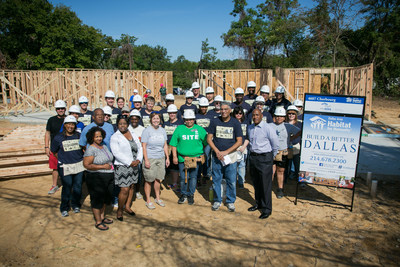 Representatives from the Federal Home Loan Bank of Dallas and Dallas Area Habitat for Humanity are shown September 12, 2015, before beginning work on the home of Gloria Gonzalez, (green shirt, center). The house at 4607 Cherbourg Street in Dallas, Texas, will be dedicated in a ceremony on Saturday, January 9, 2016.