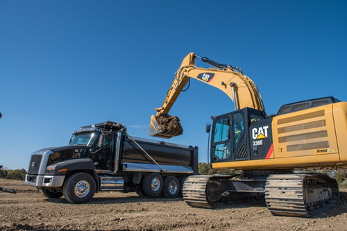 The new Cat(R) 336E H - Caterpillar's first construction hybrid machine - loads a Cat(R) CT660 truck. The ...