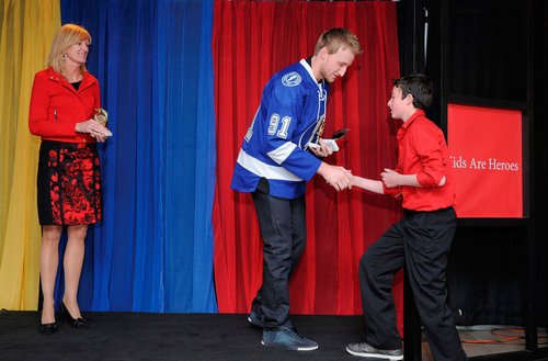 Tampa Bay Lightning Center and Kids Are Heroes Spokeschampion Steven Stamkos presents a Kids Are Heroes nominee  ...