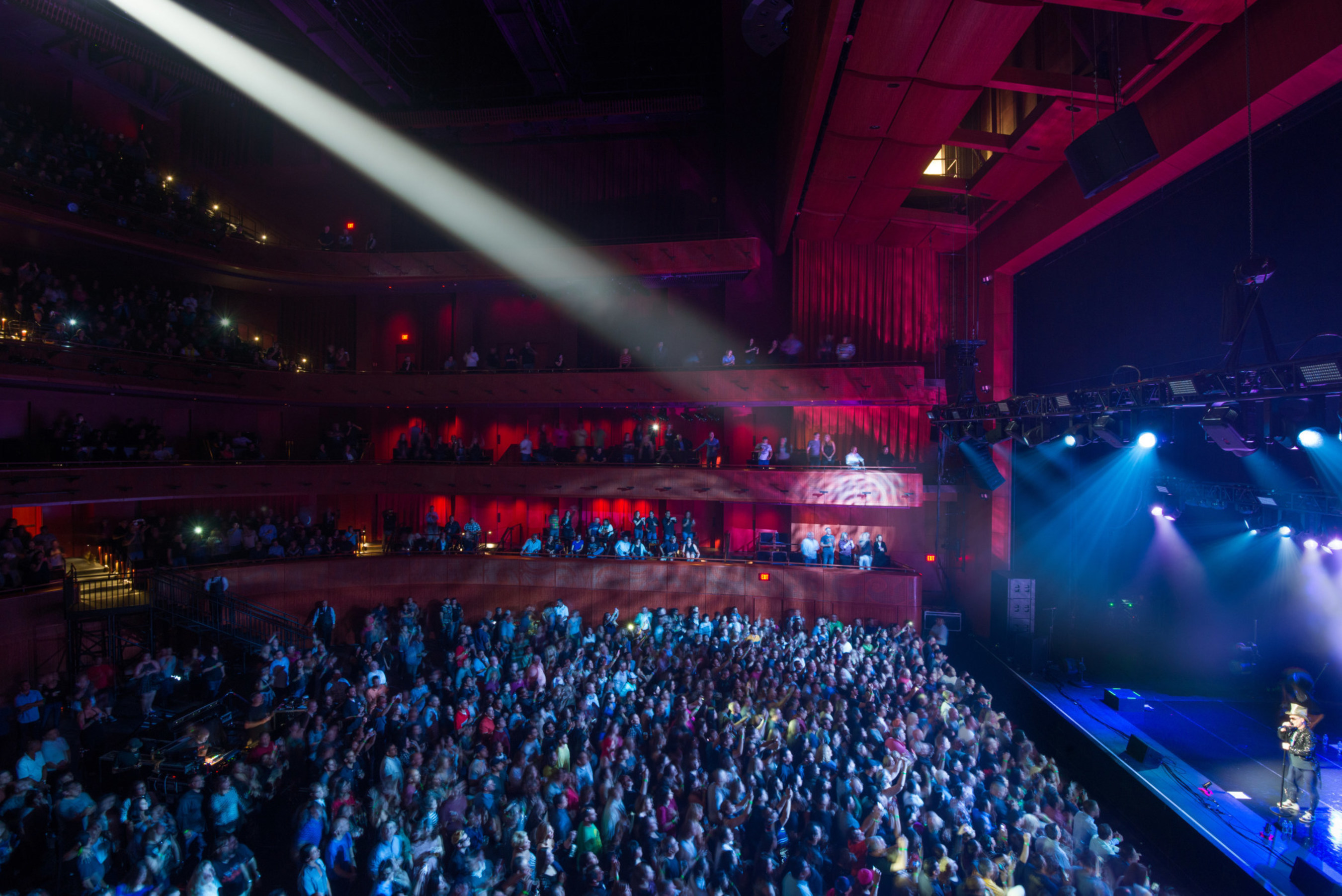 Tobin Center for the Performing Arts. The main performance hall features a movable floor which accommodates a variety of configurations to support symphony, banquet, and flat floor concerts (shown here). Image by Mark Menjivar.