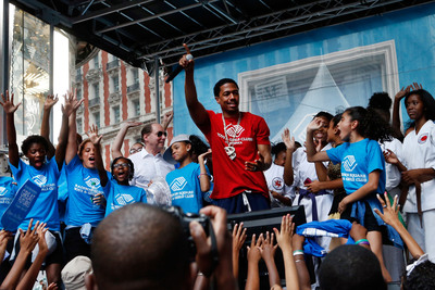 "Entertainer Nick Cannon, center, hosts Boys & Girls Clubs of America's launch of the Great Futures Campaign, to call attention to the critical role of out-of-school time for kids, in New York's Times Square, Thursday, July 31, 2014. BGCA took over Times Square to ""redefine the opportunity equation"" and garner support for after-school and summer programs that empower youth toward success. (PRNewsFoto/Boys & Girls Clubs of America)"