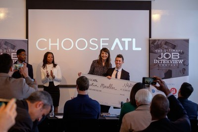 Kate Atwood, VP Marketing, Choose ATL, presenting $10,000 check to winner, Austin Mueller