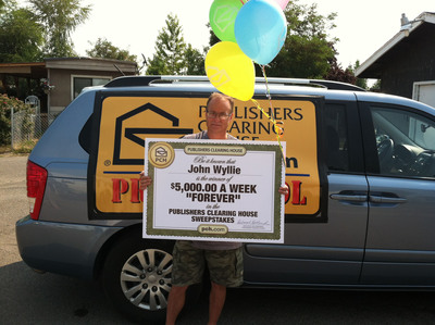 John Wyllie, 47 of White City, Oregon wins the Publishers Clearing House $5,000 A Week Forever Prize!  (PRNewsFoto/Publishers Clearing House)