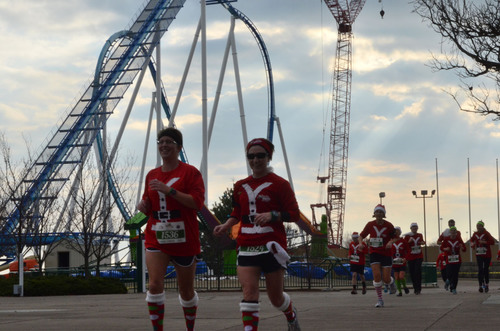 Cedar Point amusement park/resort's new GateKeeper roller coaster stands tall over the shoulders of runners  ...