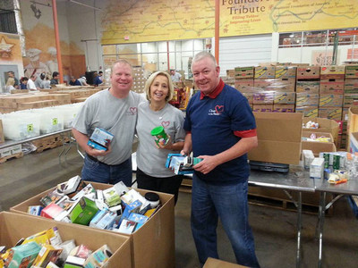 Liberty National Life Insurance Sr. VP Brenda Martin and Agency Owners Mark Woodruff and Carl Peevy at the North Texas Food Bank