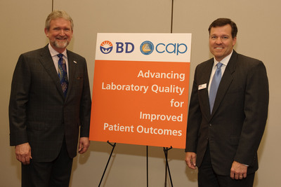 John Ledek, President, BD Diagnostics - Preanalytical Systems (right) and Gene Herbek, MD, FCAP, President-Elect of the College of American Pathologists (CAP) (left) announce a new strategic alliance between BD and CAP to improve laboratory quality and patient outcomes.  (PRNewsFoto/BD (Becton, Dickinson and Company)/College of American Pathologists)