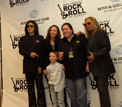 Gene Simmons, Mary Chatelle, Chuck Brennan, Vince Neil and the Brennan's son Jett at the grand opening of the Brennan Rock & Roll Academy in Sioux Falls, South Dakota.  (PRNewsFoto/Brennan Rock & Roll Academy)