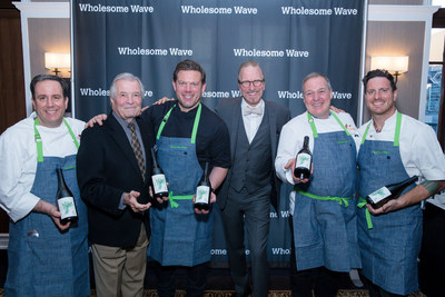 Chef Carmen Quagliata, Chef Jacques Pepin, Tyler Florence, Chef Michel Nischan, Jacques Torres and Chef Seamus Mullen holding the 2012 ONEHOPE Edna Valley Reserve Pinot Noir, with limited-edition label featuring a watercolor by Chef Jacques Pepin, benefiting Wholesome Wave.