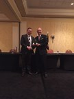 FMN International Director of Project Development Erik Hemphill accepts the National Defense Transportation Association's Distinguished Service Award at the NDTA-USTRANSCOM Fall Meeting in St. Louis, MO. FMN International is a leading provider of third party logistics (3PL)