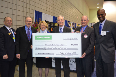 Check presentation: Left to right, Carmelo Cinqueonce, Executive Director, Minnesota Dental Association; Alejandro Aguirre, DDS, Chair, Minnesota Mission of Mercy; Ann Johnson, Executive Director, Delta Dental of Minnesota Foundation; Steve Litton, DDS, President, Minnesota Dental Foundation; Michael Flynn DDS, President, Minnesota Dental Association; Rodney Young, CEO, Delta Dental of Minnesota and Chair, Delta Dental of Minnesota Foundation.  (PRNewsFoto/Minnesota Dental Association)