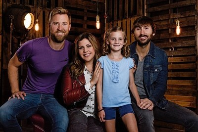 Grammy Award-winning band Lady Antebellum with St. Jude patient, Mae, for Chili's Create-A-Pepper campaign
