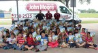 Students at Bane Elementary were all smiles today because they received a special visit from John Moore technicians (from left)  Brian Menn, Glen Gamache and Frank Wasily to deliver story books and teddy bears to the children. Bane was one of 12 schools that benefited from the event, which marked John Moore's 50th Anniversary in Houston by giving back to the community and promoting literacy. Photo credit:  Cameron Whitaker