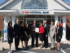 Sun National Bank was awarded the NJ Bankers' Community Service Award in Colts Neck, NJ. (Left to right: Mariluz Gonzalez, VP of Community Development, James R. Silkensen, NJ Bankers Co-President, Barbara Nymick, Freehold Branch Manager, Dana Melone, Colts Neck Personal Banker, Ed Malandro, Executive VP of Consumer Banking, Michele Estep, Executive VP and Chief Administrative Officer, John E. McWeeney, Jr, NJ Bankers Co-President, Frank Cotilla, Senior VP and Director of Facilities and Network Management, and Patricia Nelson, VP Human Resources).  (PRNewsFoto/Sun National Bank)