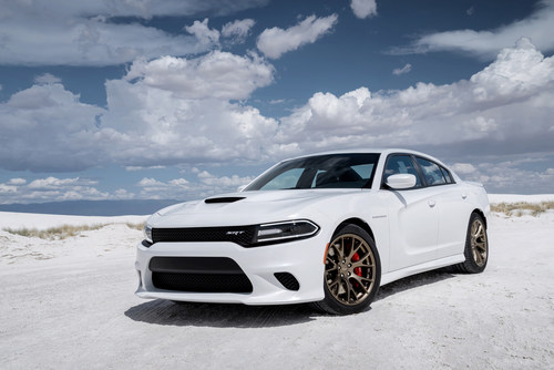 With 707 horsepower, an NHRA-certified quarter mile elapsed time of 11.0 seconds on street tires and a top speed of 204 miles per hour, the new 2015 Dodge Charger SRT Hellcat is the quickest, fastest and most powerful sedan in the world. (PRNewsFoto/Chrysler Group LLC)