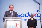 Sodexo President and CEO George Chavel joins Partnership for a Healthier America Board Chair James R. Gavin III, MD, PhD to announce the company's new commitments aimed at fighting childhood obesity at the 2014 Building a Healthier Future Summit in Washington.  (PRNewsFoto/Sodexo)