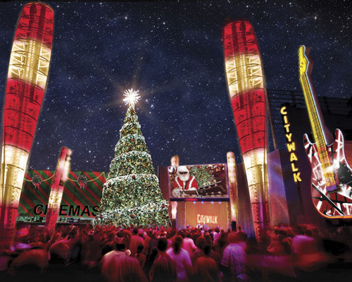 "Universal CityWalk Sparkles with Thousands of Twinkling Lights as ""5 Towers"" Unwraps the Spirited Holidays with First-of-Its-Kind, Technologically-Advanced Christmas Tree, Dazzling Light Show Display, Concert Performances and Snow Covered Rock-n-Roll Santa's Village.  (PRNewsFoto/Universal Studios Hollywood)"