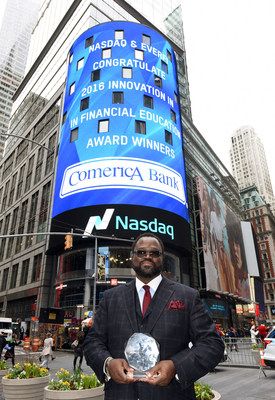 Irvin Ashford, Jr., Senior Vice President and Community Development and External Affairs Director for Comerica Bank, accepts the Innovation in Financial Education Award presented by Nasdaq and EverFi on behalf of the bank.