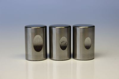 Three test rollers used in lubrication tests for abrasive wear (Reichert): Left, lubricated with water; center, using a standard cooling lubricant; right, with NOVOTECÂ(R) CL 800 (5% in each). (PRNewsFoto/GELITA AG)