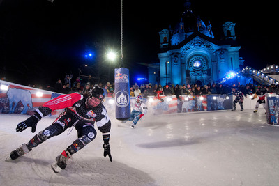 Scott Croxall (CAN) wraps around 180 degree turn ahead of Andrew Bergeson (USA), Cameron Naasz (USA) and Marco Dallago (AUT) at Red Bull Crashed Ice - Saint Paul as part of the Ice Cross Downhill World Championships.