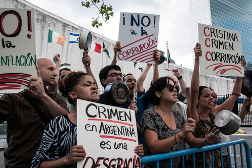 Protesters gathered outside the UN in New York City on August 6, 2013 to protest the appearance of Argentine President Cristina Kirchner while she was in town for UN Security Council Meetings.  (PRNewsFoto/American Task Force Argentina)