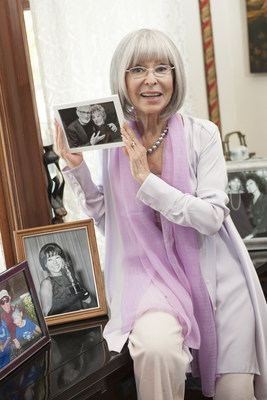 Award-winning entertainer Rita Moreno poses with a photo of her late husband, Leonard Gordon. The National Association of Insurance Commissioners today announced the launch of its campaign with Ms. Moreno to encourage seniors to get educated about their insurance and financial needs. For more information, visit www.insureuonline.org.