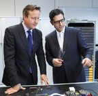 Indro Mukerjee (Chairman, FlexEnable) shows David Cameron (British Prime Minister) flexible displays and sensors created by FlexEnable.