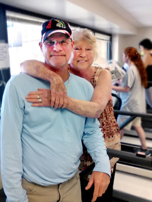 """Patricia McDaris, 64, takes a break from the treadmill to pose with her son, John McDaris. Before her lung transplant, McDaris couldn't walk because of her decreased lung function. Now she can work out, take long walks and get back to fully enjoying life. McDaris has health coverage through Staywell Heath Plan, a WellCare health plan dedicated to serving Medicaid members in Florida. """"I'm still amazed at how brilliant the doctors are and my insurance, the hospital, the hotel, my son, all the people I have come into contact with,"""" she said."""