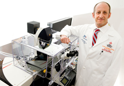 Dr. Jordan Orange, chief of Immunology, Allergy and Rheumatology and director of a new Center for Human Immunobiology at Texas Children's Hospital, with the hospital's newly acquired Leica Microsystems Gated Stimulation Emission Depletion microscope. Texas Children's is the first institution in North America to own Leica Microsystems' G-STED microscope.  (PRNewsFoto/Texas Children's Hospital)