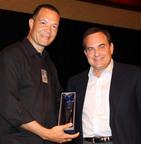 Mike McKool Receives 'Trial Lawyer of the Year' Award from Paul Stafford, Dallas Bar Association President.  (PRNewsFoto/McKool Smith)