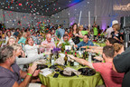 Celebration after Emeril Lagasse wins lot at 2014 Auction