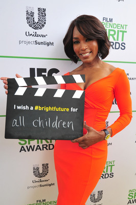 SANTA MONICA, CA - MARCH 01: Angela Bassett calls ACTION! to create a brighter future for all children on the Yellow Carpet presented by Unilever Project Sunlight during the 2014 Film Independent Spirit Awards at Santa Monica Beach on March 1, 2014 in Santa Monica, California. (Photo by Mark Sullivan/WireImage)