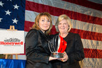 Honeywell Hometown Solutions Director Kerry Kennedy presents the Honeywell Hometown Heroes Award to USSRC CEO Deborah Barnhart