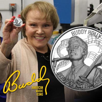 "Maria Elena Holly displays ""Buddy Holly: Not Fade Away"" commemorative silver coin."