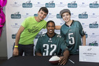 Eagles Cornerback #32 Eric Rowe poses with two young guests at the Eagles and CHOP's 2016 Huddle Up for Autism at Lincoln Financial Field.