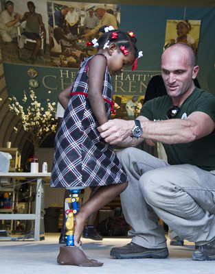 First Steps: Prosthetist Adam Finnieston helps three-year-old Anaika Pierre takes her first steps on two legs a year after Haiti's 2010 earthquake. She was fitted with a new prosthetic leg at the Knights of Columbus--funded facility in Port-au-Prince.