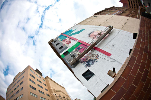 Chicago artist, Jeff Zimmermann is shown here creating a seven-story mural as his ArtPrize entry. His mural is ...