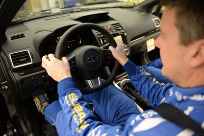Subaru Rally Team USA driver David Higgins in the 2015 WRX STI. (PRNewsFoto/Subaru of America, Inc.)