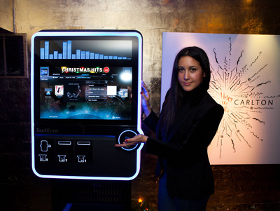 Vanessa Carlton with TouchTunes Interactive Networks' Virtuo.  (PRNewsFoto/TouchTunes Interactive Networks)