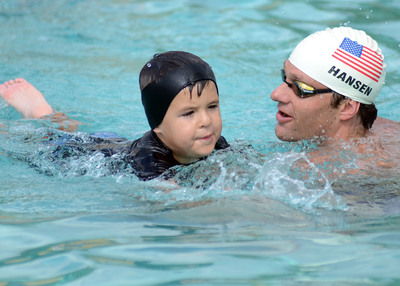 Olympian Brendan Hansen and a young participant in the 2013 World's Largest Swimming Lesson Record Attempt.   (PRNewsFoto/World's Largest Swimming Lesson, Aquatica, SeaWorld's Water Park- San Antonio)