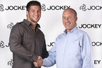 Pro Football Quarterback Tim Tebow Signs with Jockey.  (PRNewsFoto/Jockey International, Inc.)