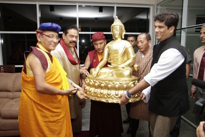 The President of Sri Lanka, Mahinda Rajapaksha being presented the large size Buddha statue by the Gyalwang Drukpa and Arjun Pandey (Head of Live to Love India)