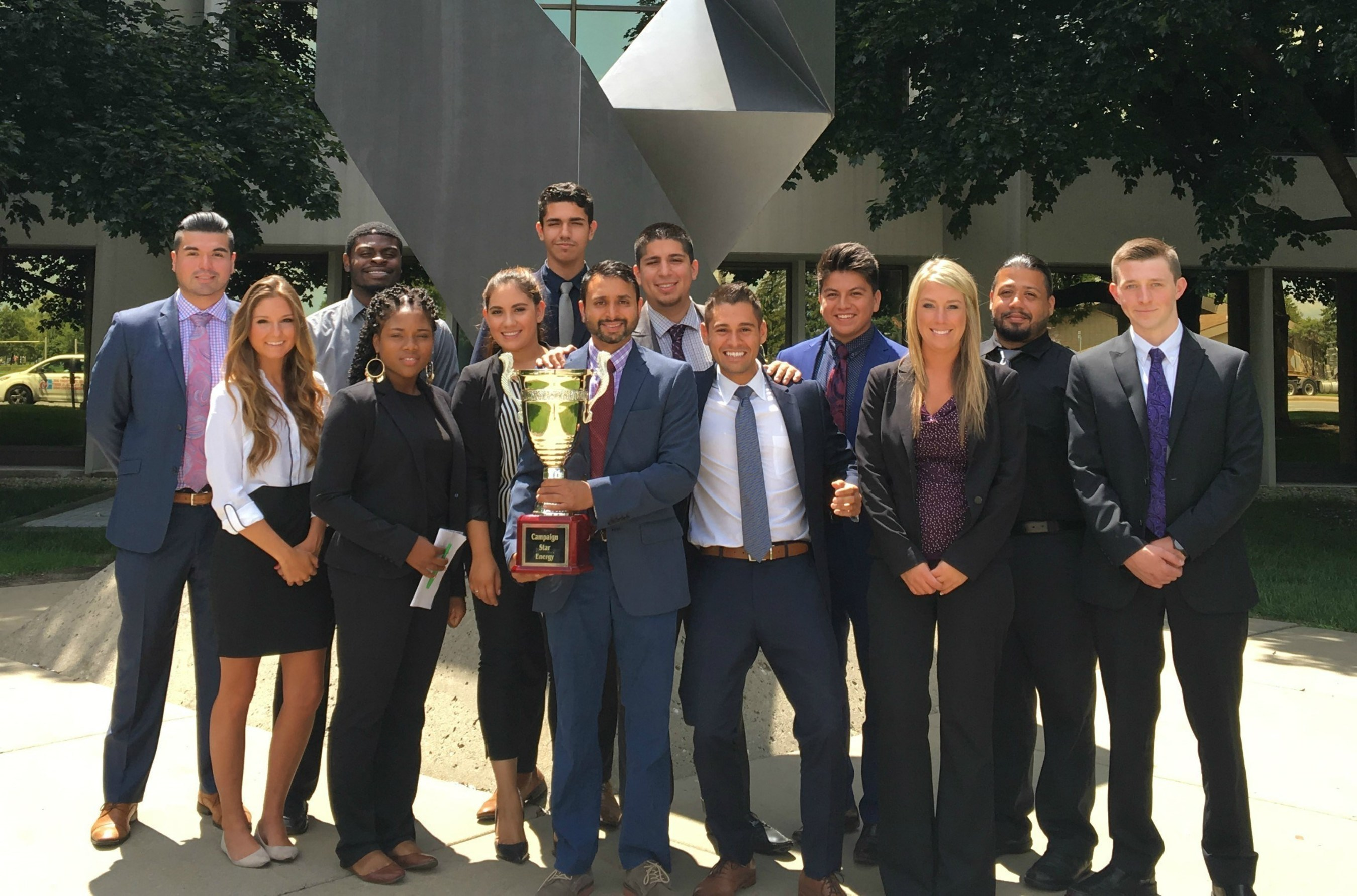 Marketing and consulting company One Chicago, Inc. received a national sales award for outstanding results on behalf of a prestigious energy client. President Juan Olmos and the One Chicago staff pose with the Campaign Cup trophy.
