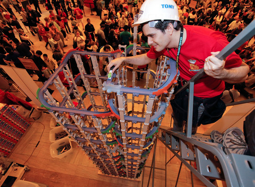 TOMY Master Builder Jason Moreno prepares to send a Chuggington die-cast railway train down a tower constructed of 17 feet, four inches of Chuggington StackTrack, which set the GUINNESS WORLD RECORDS Title for tallest toy train track Saturday, May 11, 2013 at Grand Central Terminal.  (PRNewsFoto/TOMY International)