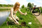 "A Dutch girl is sowing bee-friendly flower seeds along a bicycle trail in the Netherlands, for Nature & More's ""Bees love Organic"" campaign."