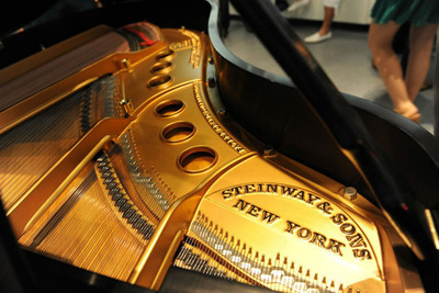 Specialist Steinway Piano dealer showcases Golden Age Steinway Grands alongside Luxury Cars.  (PRNewsFoto/Park Avenue Pianos)