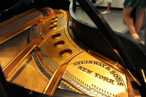 Specialist Steinway Piano dealer showcases Golden Age Steinway Grands alongside Luxury Cars.  (PRNewsFoto/Park ...