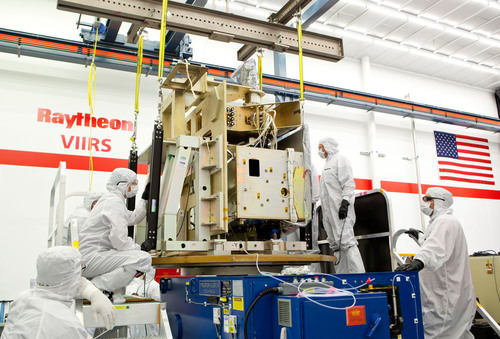 Raytheon technicians prepare the integrated VIIRS JPSS-1 sensor for ambient testing. (PRNewsFoto/Raytheon Company) (PRNewsFoto/RAYTHEON COMPANY)