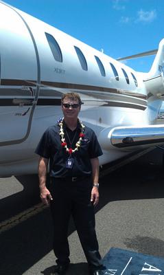 Captain Bryan Alexander in front of an XOJET Citation X.  (PRNewsFoto/XOJET)