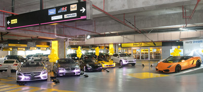 Hertz celebrates 25,000th Dream Cars rental on Wednesday, Sept. 3, 2014 in Miami. (Mitchell Zachs/AP Images for Hertz)